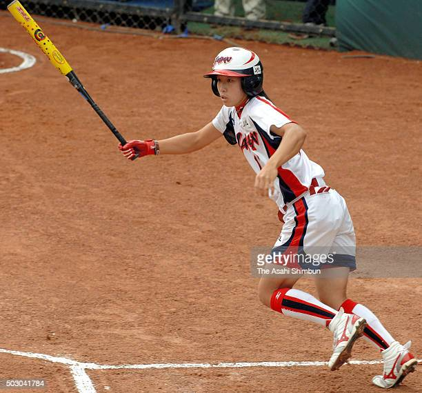 Eri Yamada of Japan hits a RBI single in the top of first inning during the Softball Women's World Championship Group B match between Japan and...