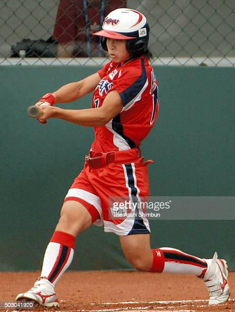 Eri Yamada of Japan hits a solo homer in the bottom of first inning during the Softball Women's World Championship Group B match between Japan and...