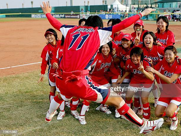 Eri Yamada of Japan jumps in celebration in front of her team after winning the gold medal in the game against Chinese Taipei at the 15th Asian Games...