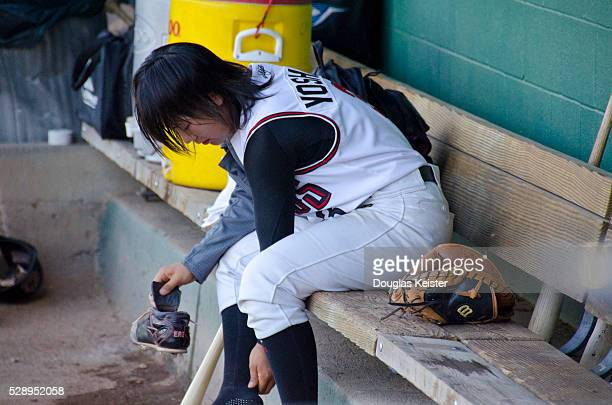 Eri Yoshida the 19 year old female knuckleball pitcher from Japan in the dugout at a game in Chico California where she pitched for the Chico Outlaws...