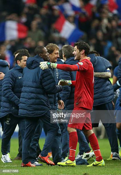 Eric Abidal and Hugo Lloris of France celebrates the victory at the end of the FIFA 2014 World Cup Qualifier playoff second leg match between France...