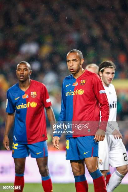 Eric Abidal and Thierry Henry of Barcelona during the Liga match between Barcelona and Real Madrid at Camp Nou Barcelona Spain on December 13th 2008