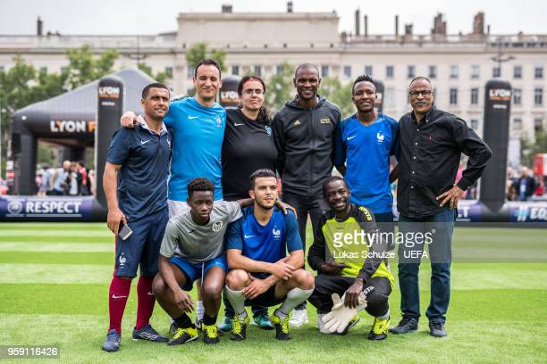 Eric Abidal chats with players of the International Homeless Team of France at the Fan Zone ahead of the UEFA Europa League Final between Olympique...