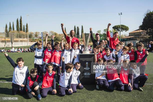 Eric Abidal Delantero09 and Cacho01 pose with the UEFA Europa League Trophy as part of the #PassThemOn campaign on February 21 2020 in Barcelona...