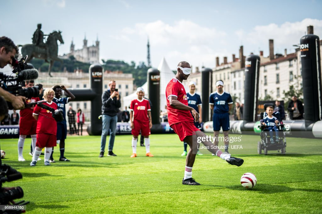 Eric Abidal kicks a ball with a mask to feel like a blind player during the EqualGame Match at the Fan Zone ahead of the UEFA Europa League Final between Olympique de Marseille and Club Atletico de Madrid at Stade de Lyon on May 15, 2018 in Lyon, France.