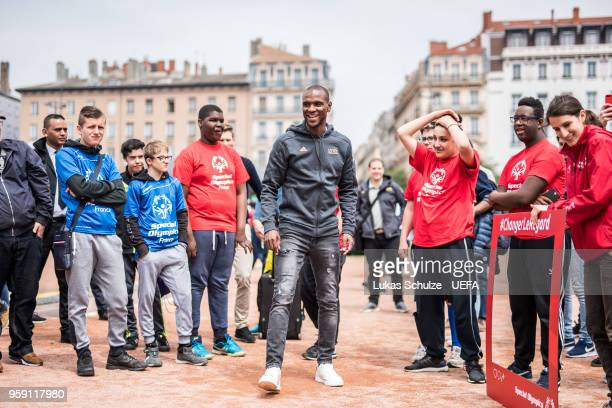 Eric Abidal kicks with members of Special Olympics at the Fan Zone ahead of the UEFA Europa League Final between Olympique de Marseille and Club...