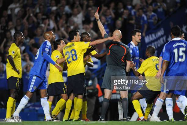 Eric Abidal of Barcelona is shown a red card by referee Tom Henning Ovrebo during the UEFA Champions League semi final second leg match between...