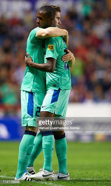 Eric Abidal of Barcelona is substituted by Andreu Fontas during the La Liga match between Levante UD and Barcelona at Ciutat de Valencia on May 11...