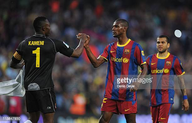 Eric Abidal of Barcelona shakes hands with Idriss Kameni of Espanyol at the end of the La Liga match between Barcelona and Espanyol at Nou Camp on...