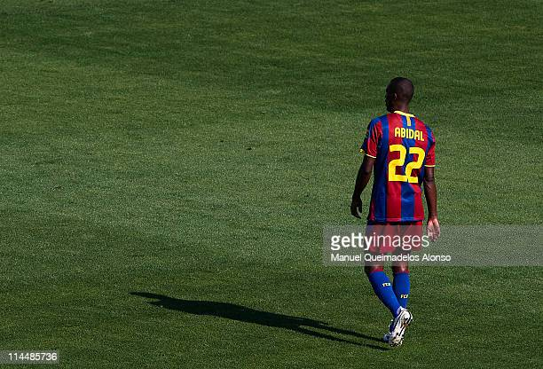 Eric Abidal of Barcelona walks on the pitch during the La Liga match between Malaga and Barcelona at La Rosaleda Stadium on May 21 2011 in Malaga...