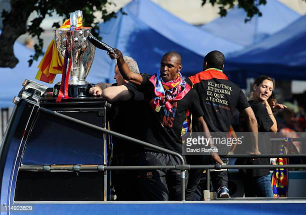 Eric Abidal of FC Barcelona celebrates on board an open top bus after winning the UEFA Champions League Final against Manchester United on May 29...