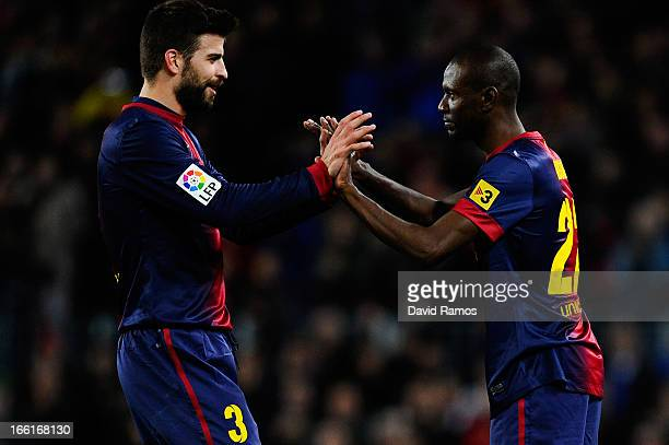 Eric Abidal of FC Barcelona comes on for Gerard Pique of FC Barcelona during the La Liga match between FC Barcelona and RCD Mallorca at Camp Nou on...