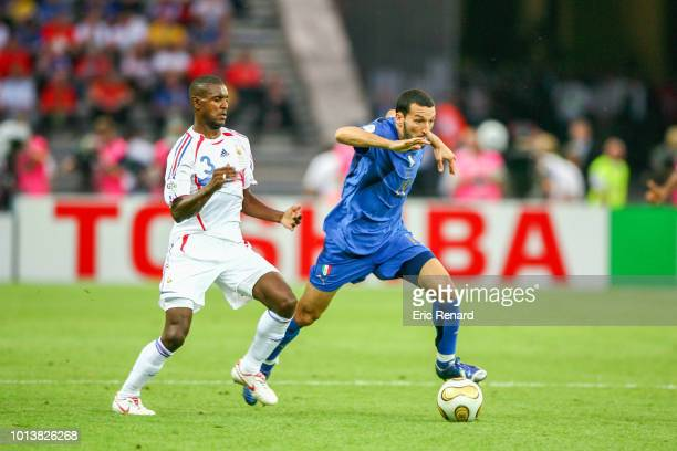 Eric Abidal of France and Gianluca Zambrotta of Italy during the World Cup final match between Italy and France at the Olympiastadion in Berlin...