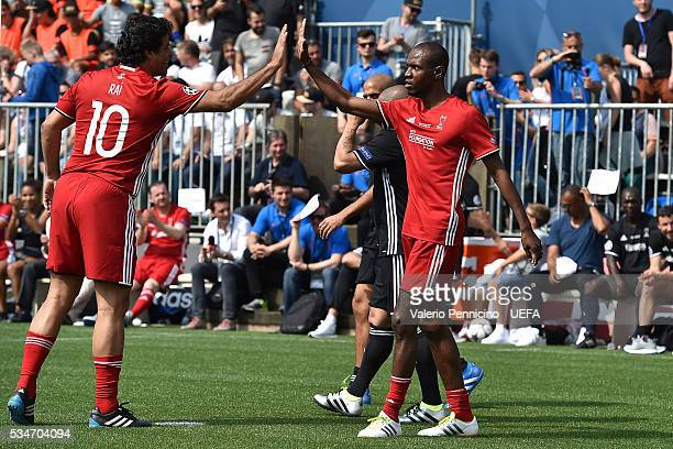 Eric Abidal of World AllStars celebrates his goal with team mate Rai during the Ultimate Champions Match between Milan Inter Legends and World...