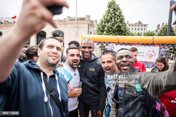 Eric Abidal poses with fans at the Fan Zone ahead of the UEFA Europa League Final between Olympique de Marseille and Club Atletico de Madrid at Stade...