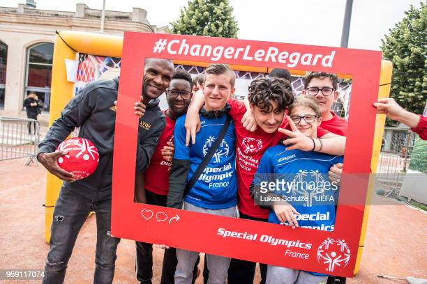 Eric Abidal poses with members of Special Olympics at the Fan Zone ahead of the UEFA Europa League Final between Olympique de Marseille and Club...