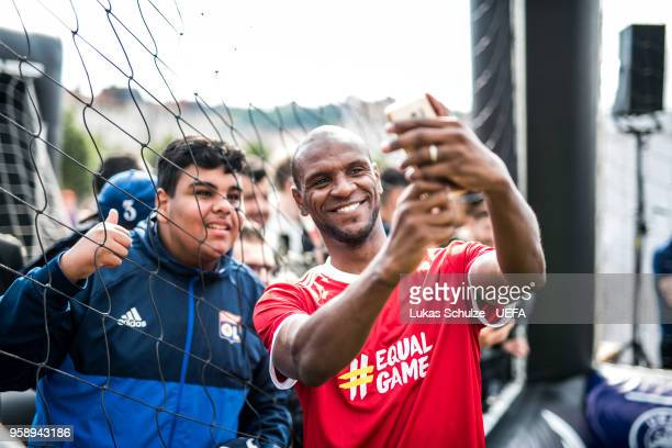 Eric Abidal takes a selfie with an fan after the EqualGame at the Fan Zone ahead of the UEFA Europa League Final between Olympique de Marseille and...