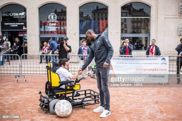 Eric Abidal with a player of the European Powerchair Football Association at the Fan Zone ahead of the UEFA Europa League Final between Olympique de...