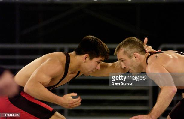 Eric Akin of the Black Team in action against Eric Guerrero of the Red Team in the 60kg Freestyle Division
