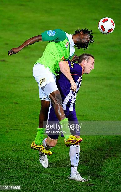 Eric Akoto of the Fury contests the ball with Michael Baird of the Glory during the round ten ALeague match between the North Queensland Fury and the...