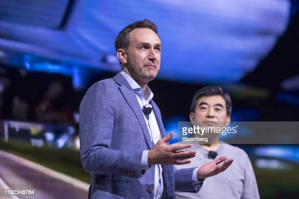Eric Allison head of elevate at Uber Technologies Inc left speaks as Jaiwon Shin executive vice president and head of Urban Air Mobility Division at...