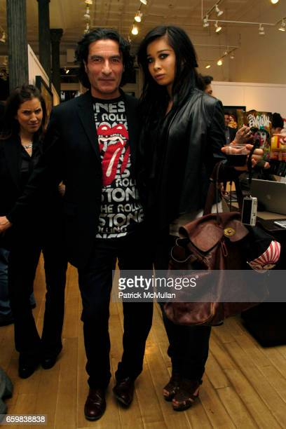Eric Allouche and AJ Nguyen attend IMMORTAL UNDERGROUND by RON ENGLISH at Opera Gallery on November 12 2009 in New York City