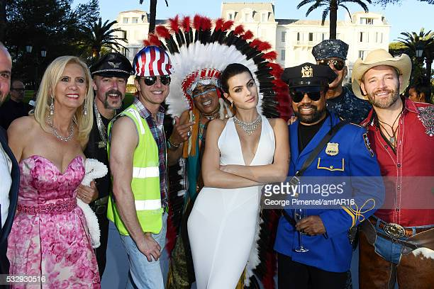 Eric Anzalone Bill Whitefield Felipe Rose model Isabeli Fontana Ray Simpson Alex Briley and Jim Newman of the band Village People attend the amfAR's...