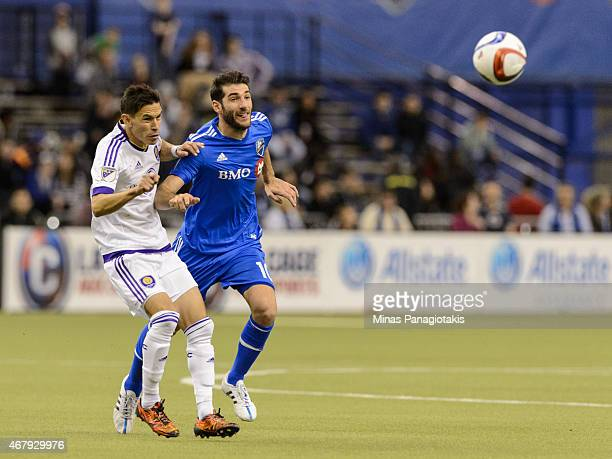 Eric Avila of Orlando City SC and Ignacio Piatti of Montreal Impact chase the ball during the MLS game at the Olympic Stadium on March 28 2015 in...