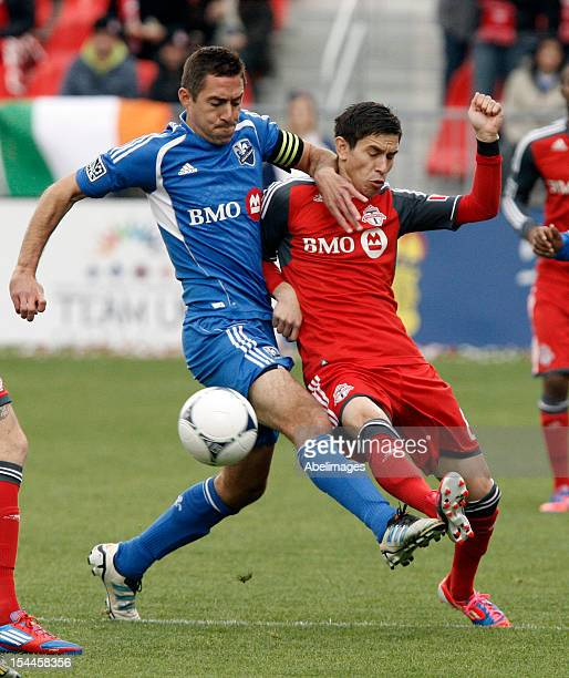 Eric Avila of Toronto FC runs into Davy Arnaud of the Montreal Impact during MLS action at BMO Field October 20 2012 in Toronto Ontario Canada