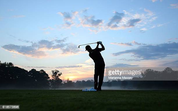 Eric Axley practices on the range prior to teeing off during the First Round of the Sanderson Farms Championship at the Country Club of Jackson on...