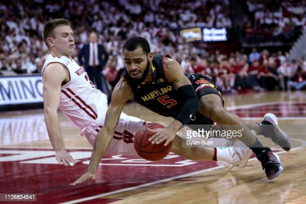 Eric Ayala of the Maryland Terrapins draws a foul against Brad Davison of the Wisconsin Badgers in the second half at the Kohl Center on February 01...