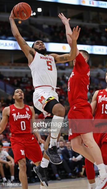 Eric Ayala of the Maryland Terrapins drives to the basket past Thorir Thorbjarnarson of the Nebraska Cornhuskers at the United Center on March 14...