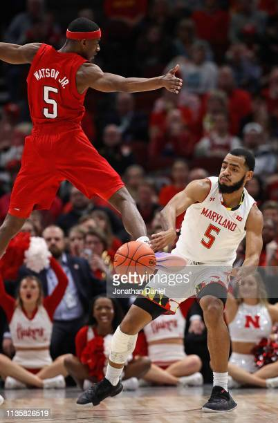 Eric Ayala of the Maryland Terrapins passes around Glynn Watson Jr #5 of the Nebraska Cornhuskers at the United Center on March 14 2019 in Chicago...
