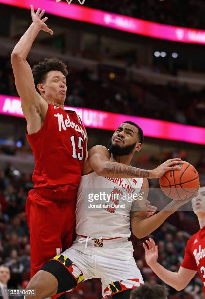 Eric Ayala of the Maryland Terrapins tries to get off a shot against Isaiah Roby of the Nebraska Cornhuskers at the United Center on March 14 2019 in...
