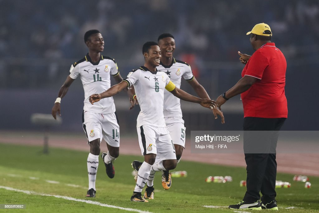 Eric Ayiah of Ghana (C) #6 celebrates with his team-mates and head coach Samuel Fabin after scoring his team's second goal to make it 2-0 during the FIFA U-17 World Cup India 2017 group A match between Ghana and India at Jawaharlal Nehru Stadium on October 12, 2017 in New Delhi, India.
