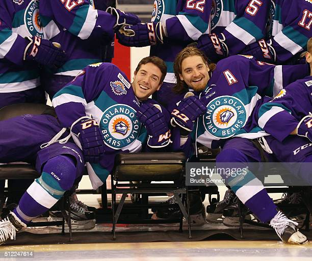 Eric Baier and Johnny McInnis of Orlando Solar Bears goof around following the official team photo at the Amway Center on February 12 2016 in Orlando...