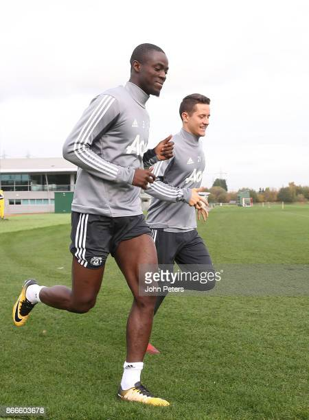 Eric Bailly and Ander Herrera of Manchester United in action during a first team training session at Aon Training Complex on October 26 2017 in...