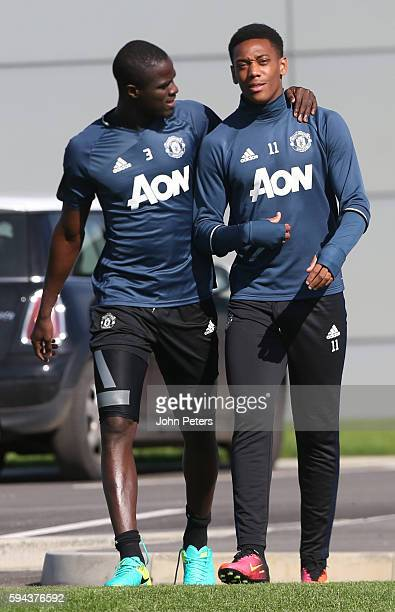 Eric Bailly and Anthony Martial of Manchester United in action during a first team training session at Aon Training Complex on August 23 2016 in...
