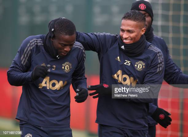 Eric Bailly and Antonio Valencia of Manchester United in action during a first team training session ahead of the UEFA Champions League Group H match...