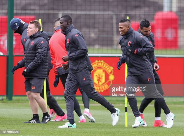 Eric Bailly and Antonio Valencia of Manchester United in action during a first team training session at Aon Training Complex on April 12, 2017 in...