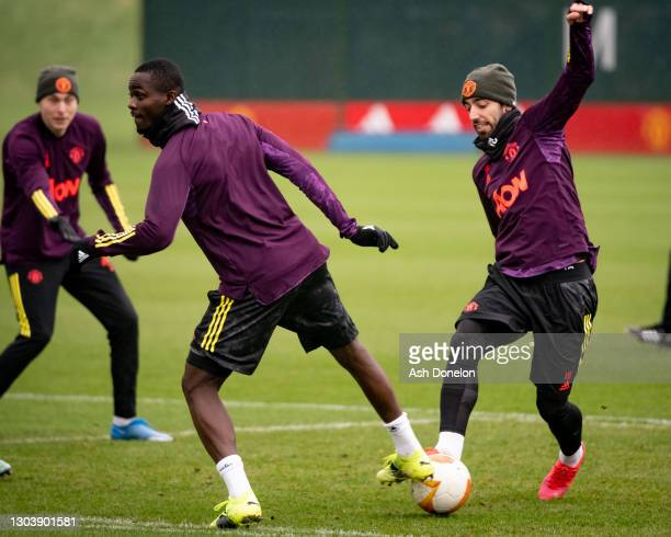 Eric Bailly and Bruno Fernandes of Manchester United in action during a first team training session at Aon Training Complex on February 24, 2021 in...
