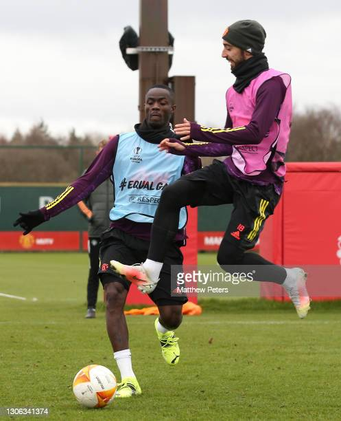 Eric Bailly and Bruno Fernandes of Manchester United in action during a first team training session at Aon Training Complex on March 10, 2021 in...