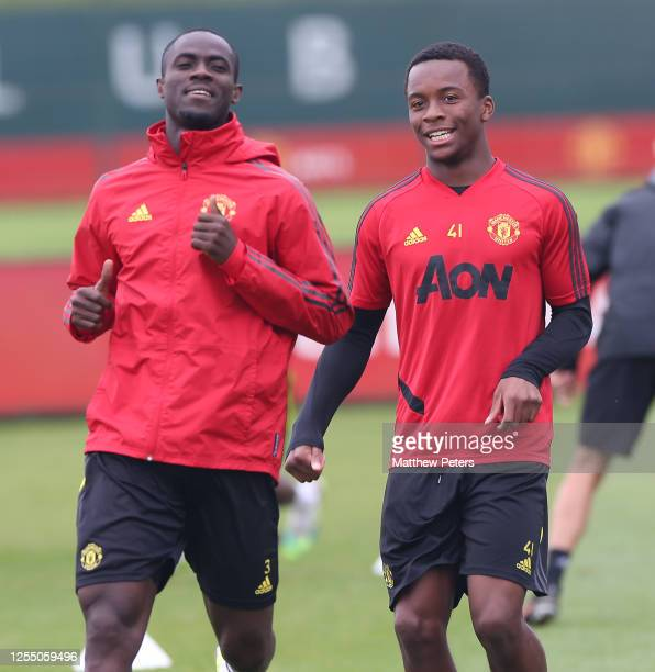 Eric Bailly and Ethan Laird of Manchester United in action during a first team training session at Aon Training Complex on July 08 2020 in Manchester...