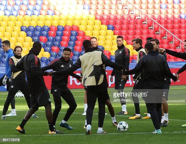 Eric Bailly and Jesse Lingard of Manchester United in action during a training session ahead of their UEFA Champions League match against CSKA Moscow...