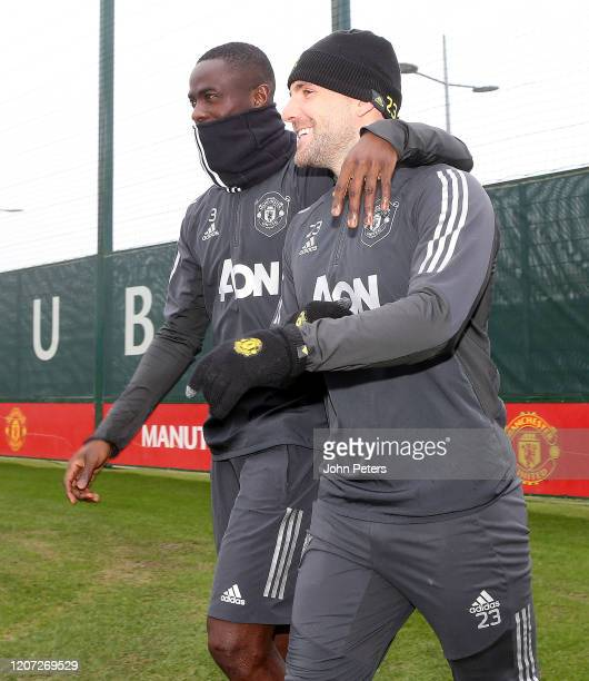 Eric Bailly and Luke Shaw of Manchester United in action during a first team training session at Aon Training Complex on February 19 2020 in...