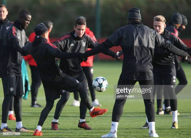 Eric Bailly Ander Herrera and Scott McTominay of Manchester United in action during a training session at Aon Training Complex on October 30 2017 in...