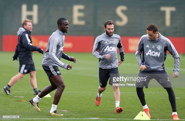 Eric Bailly Juan Mata and Nemanja Matic of Manchester United in action during a first team training session at Aon Training Complex on October 26...