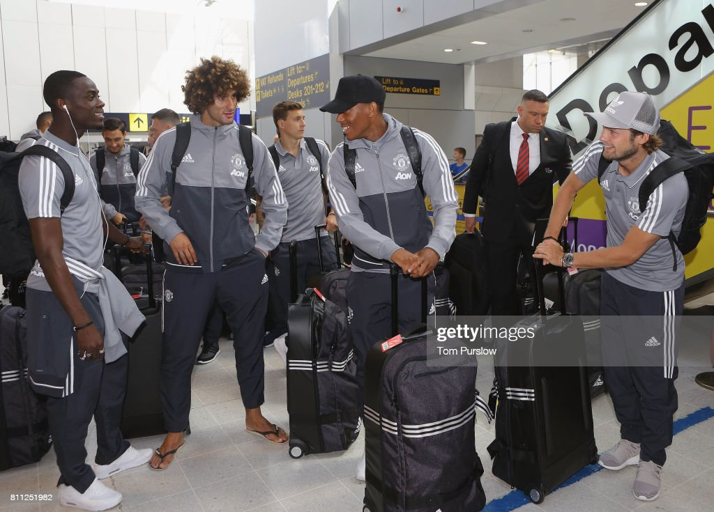 Eric Bailly, Marouane Fellaini, Victor Lindelof, Anthony Martial and Daley Blind of Manchester United check in at Manchester Airport ahead of the club's pre-season tour of the USA at Manchester Airport on July 9, 2017 in Manchester, England.