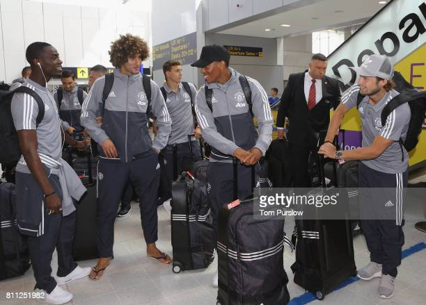Eric Bailly Marouane Fellaini Victor Lindelof Anthony Martial and Daley Blind of Manchester United check in at Manchester Airport ahead of the club's...
