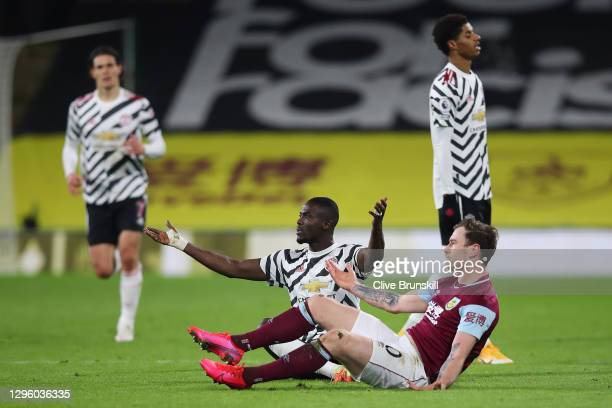 Eric Bailly of Manchester United and Ashley Barnes of Burnley react during the Premier League match between Burnley and Manchester United at Turf...